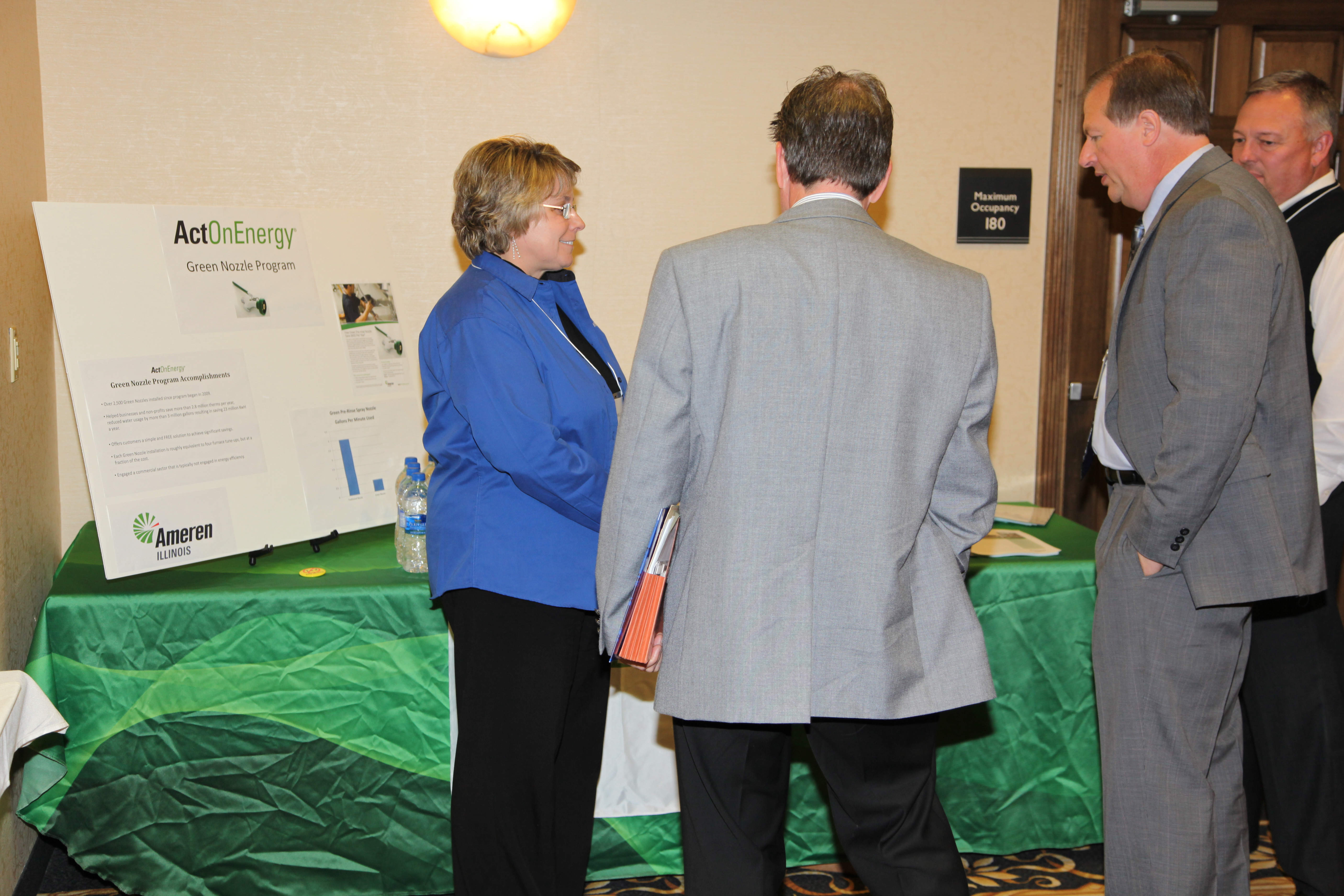 Exhibitors talk during Gov. Awards event