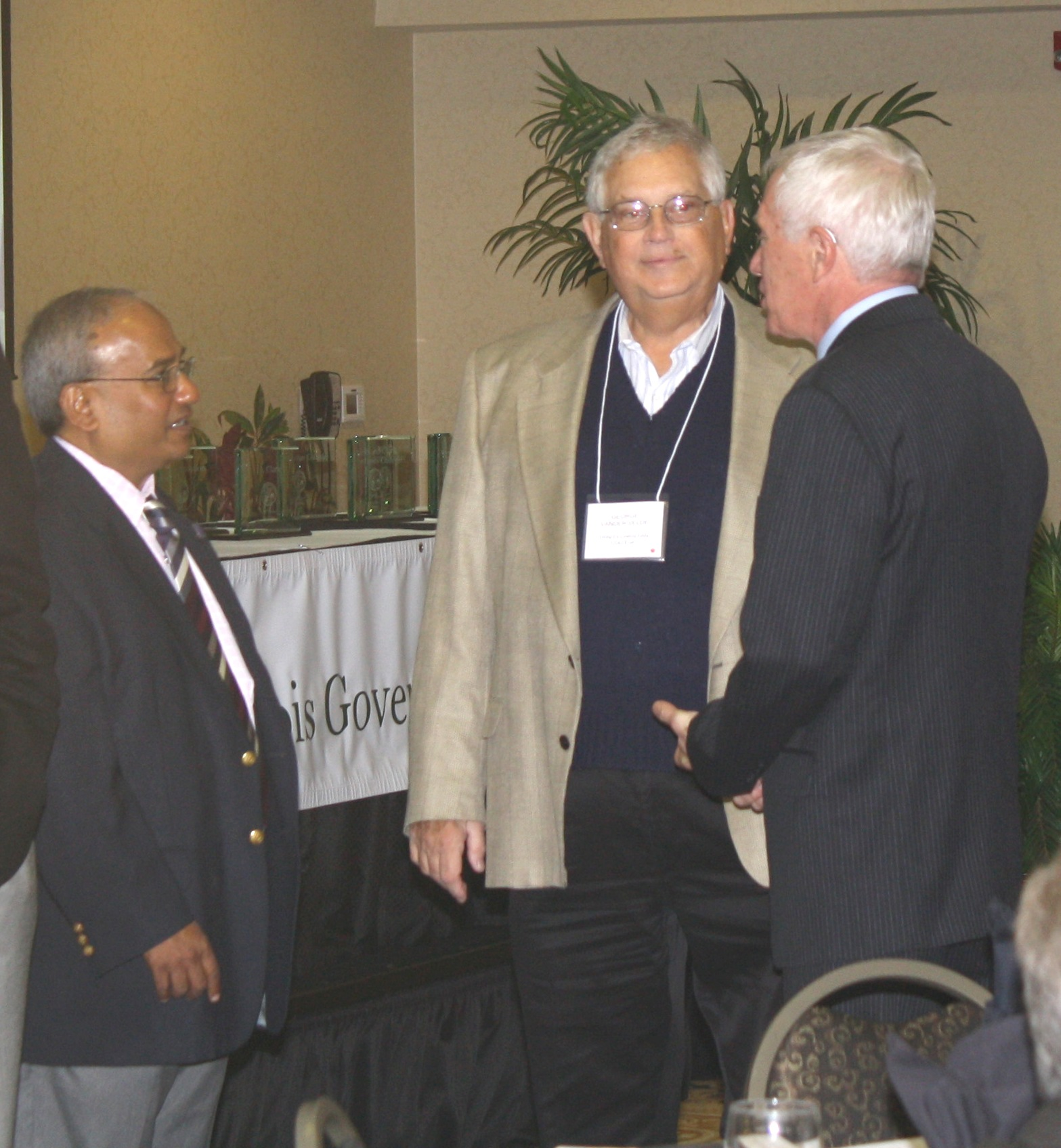 Manohar Kulkarni, former ISTC Director, speaks with past ISTC Director George VanderVelde and Gary Miller