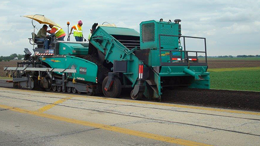 road building machine lays asphalt