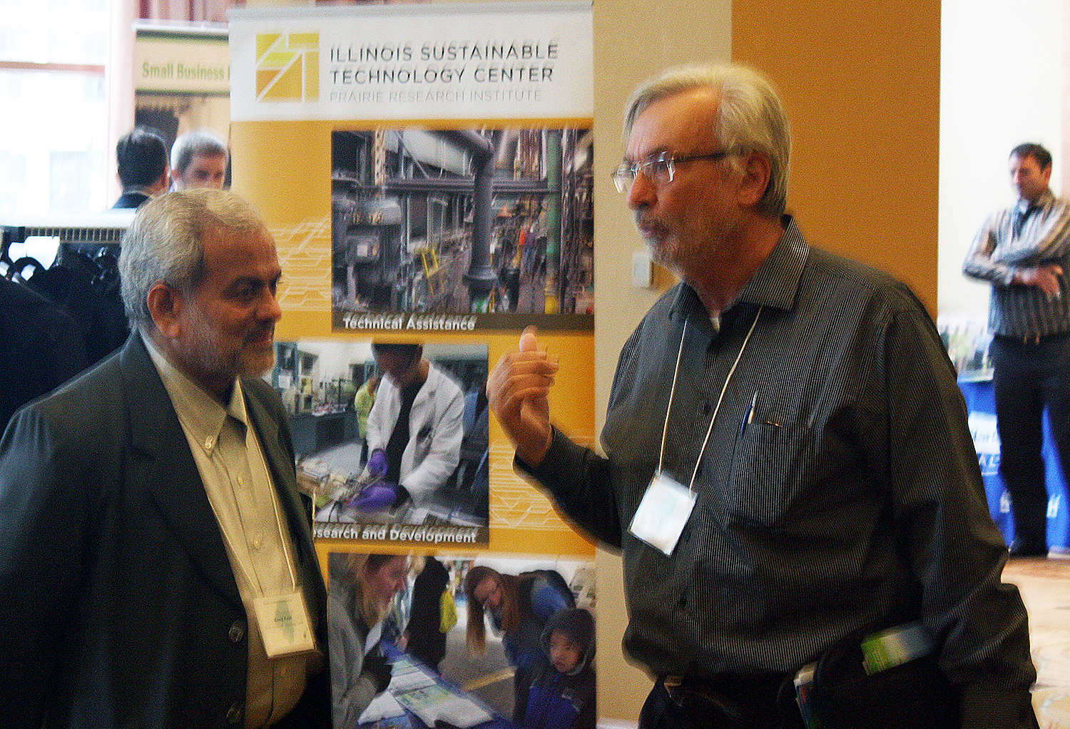 Vinod Patel talking with an attendee