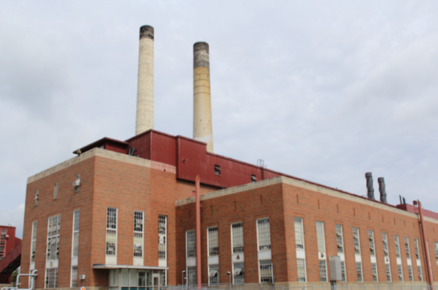Abbott Power Plant: brick building with tall think windows and two smoke stacks.